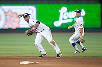 Winston-Salem Dash shortstop Cleuluis Rondon (13) makes a throw to first base as second baseman Toby Thomas (4) looks on during the game against the Potomac Nationals at BB&T Ballpark on May 13, 2016 in Winston-Salem, North Carolina.  The Dash defeated the Nationals 5-4 in 11 innings.  (Brian Westerholt/Four Seam Images)
