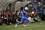 7 June 2007: El Salvador's Eliseo Quintanilla (21) tries to keep the ball in play in front of the Trinidad bench. The National Team of El Salvador defeated the National Team of Trinidad & Tobago 2-1 at the Home Depot Center in Carson, California in a first round game in the CONCACAF Gold Cup.