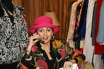 Robin Strasser of One Life To Live is on the phone with a gentleman who donated at an in-store appearance on August 16, 2009 at Housing Works Upper East Side Thrift Shop, New York City, New York. Robin donated a full rack of clothes and truckload of furniture to Housing Works and fans came to see and buy many many of  the items ranging from her great variety of clothes, jewelry, hats, furniture, backpacks and other items. This way the fans have momentos and wearables of Robin Strassers while donating to Housing Works. (Photo by Sue Coflin/Max Photos)