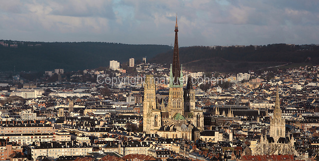 View of the city of Rouen, with Rouen Cathedral or the Cathedrale de Notre Dame de Rouen, built 12th century in Gothic style, with work continuing through the 13th and 14th centuries, and bottom right, the Church of Saint Maclou, a 15th century Gothic church, Rouen, Normandy, France. Picture by Manuel Cohen