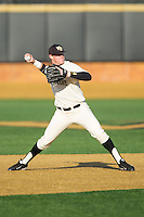 Wake Forest Demon Deacons shortstop Conor Keniry (14) makes a throw to first base against the Towson Tigers at Wake Forest Baseball Park on February 15, 2014 in Winston-Salem, North Carolina.  The Tigers defeated the Demon Deacons 5-4.  (Brian Westerholt/Four Seam Images)