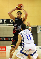 Saints guard Luke Martin pressures Trenton Wurtz during the NBL match between the Wellington Saints and Christchurch Cougars at Te Rauparaha Stadium, Porirua, Wellington, New Zealand on Saturday 4 April 2009. Photo: Dave Lintott / lintottphoto.co.nz