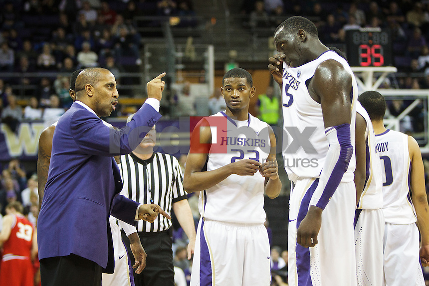 Lorenzo Romar and Aziz N'Diaye - University of Washington Huskies take on the Seattle University Redhawks at Hec Edmundson Pavilion at Alaska Airlines Arena in Seattle Tuesday, Jan. 10, 2012. (Photography by Andy Rogers/Red Box Pictures)