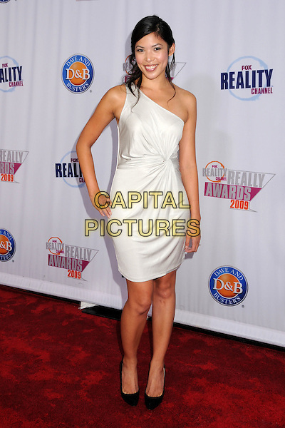 TAMMY JIH.2009 Fox Reality Channel Really Awards held at the Music Box Theatre, Hollywood, California, USA..October 13th, 2009.full length white one shoulder dress  hand on hip.CAP/ADM/BP.©Byron Purvis/AdMedia/Capital Pictures.