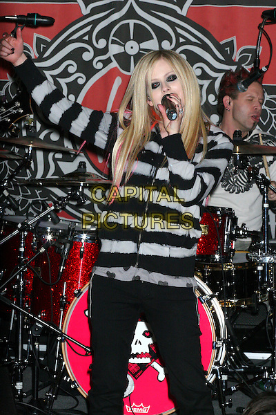 AVRIL LAVIGNE.At her In-Store Performance at Virgin Megastore, New York, NY, USA..April 18th, 2007.half length black grey gray top pink hair streaks eyeliner makeup make up make-up live in concert gig performance microphone nail varnish polish trousers arm in air.CAP/IW.©Ian Wilson/Capital Pictures
