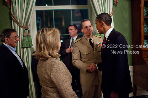 United States President Barack Obama shakes hands with Admiral Mike Mullen, Chairman of the Joint Chiefs of Staff, in the Green Room of the White House, following his statement detailing the mission against Osama bin Laden, Sunday, May 1, 2011. CIA Director Leon Panetta and Secretary of State Hillary Rodham Clinton are pictured at left. .Mandatory Credit: Pete Souza - White House via CNP