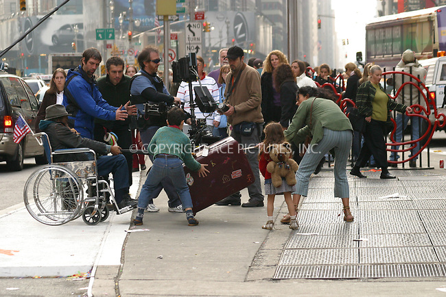 "***EXCLUSIVE***..Italian Actress Maria Grazia Cucinotta is filming scenes for her new movie ""Rent-a-Husband""  in Times Square, New York. In the scene, a man in the wheelchair tries to steal her luggage, but Maria's character claims it back, grabs her children and runs across the street through heavy traffic. November 10, 2002. Please byline: Alecsey Boldeskul/NY Photo Press.   ..*PAY-PER-USE*      ....NY Photo Press:  ..phone (646) 267-6913;   ..e-mail: info@nyphotopress.com"