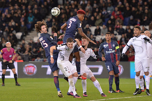 11.01.2017. Paris, France. French league cup football, Paris Saint Germain versus FC Metz.   Adrien RABIOT (psg) and PRESNEL KIMPEMBE (psg)  win the header from Chris PHILIPPS (metz)