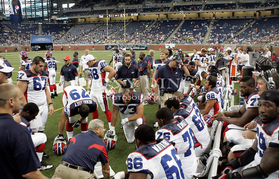 Buffalo Bills offensive linemen huddle around offensive line coach Joe D'Alessandris, bottom left, in the second quarter of a preseason NFL football game with the Detroit Lions, Thursday, Sept. 2, 2010, in Detroit. (AP Photo/Tony Ding)
