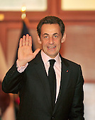 Washington, D.C. - March 30, 2010 -- President Nicolas Sarkozy of France waves to the photographers as he arrives for a visit with the Speaker of the United States House of Representatives Nancy Pelosi (Democrat of California), not pictured, in the U.S. Capitol on Tuesday, March 30, 2010..Credit: Ron Sachs / CNPWashington, D.C. - March 30, 2010 -- President Nicolas Sarkozy of France visits the Speaker of the United States House of Representatives Nancy Pelosi (Democrat of California) in the U.S. Capitol on Tuesday, March 30, 2010..Credit: Ron Sachs / CNP