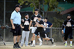 POWAY, CA - JULY 16:  Quarterback Philip Rivers of the San Diego Chargers coaches third base for his team the &quot;Valley Farm League&quot;  during their semi-final game in the Regular Joe League at the Poway Sportsplex Softball Field on July 16, 2014 in Poway, California. (CREDIT: Donald Miralle for the Wall Street Journal) <br /> chargers