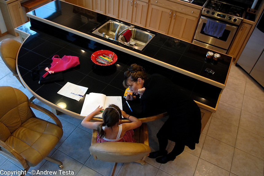 USA. Wasilla..  13th September 2007.Governor Palin helps her daughter Piper with her homework at their home in Wasilla..©Andrew Testa/Panos