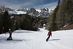 Snowboarder at Ciampac Ski Area in the Dolomites, Canazei, Italy,