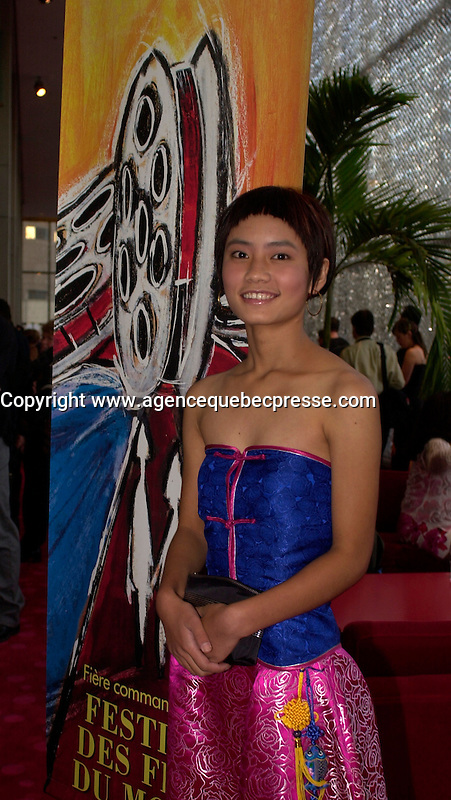 August 27,  2003, Montreal, Quebec, Canada<br /> <br /> Li Min, main actress in Zhang Jiarui movie<br /> RUOMA DE SHI SUI (When Ruoma was seventeen), presented in the Official Competition of the<br />  2003 Montreal World Film Festival, pose for an exclusive photo, august 27 2003<br /> <br /> The Festival runs from August 27th to september 7th, 2003<br /> <br /> <br /> Mandatory Credit: Photo by Pierre Roussel- Images Distribution. (&copy;) Copyright 2003 by Pierre Roussel <br /> <br /> All Photos are on www.photoreflect.com, filed by date and events. For private and media sales