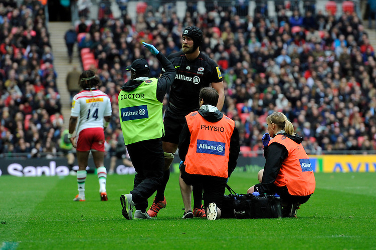 Alistair Hargreaves of Saracens is taken off the pitch to be  assessed for a head injury