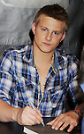 LOS ANGELES, CA - MARCH 22: Alexander Ludwig of Lionsgate's 'The Hunger Games' poses at Barnes & Noble at The Grove on March 22, 2012 in Los Angeles, California.