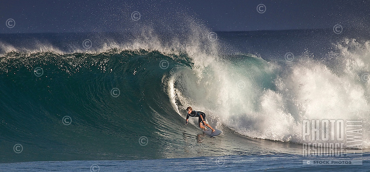 A surfer in the tube at Backdoor, on Oahu's North Shore.