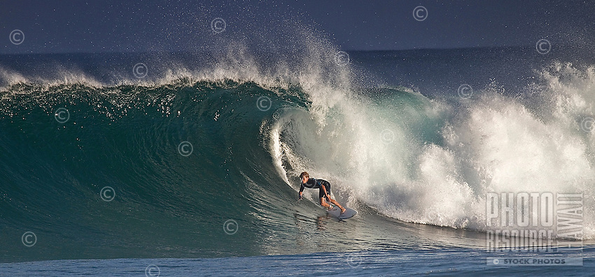 A surfer in the tube atBackdoor, on Oahu's North Shore.