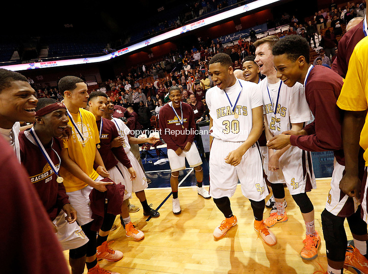 Uncasville, CT- 22 March 2015-032215CM35- Sacred Heart boys basketball team celebrates including Isaiah Rascoe, (30) , after the Hearts defeated Valley Regional in Class S state championship game at Mohegan Sun Arena in Uncasville on Sunday. The Hearts won, 71-46.    Christopher Massa Republican-American