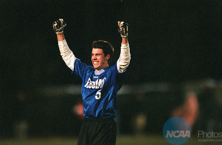 25 NOV 2000:  Midfielder Matt Crist (5) of Messiah College celebrates his teams victory against Rowan University during the Division 3 Men's Soccer Championship held on the Rowan University campus in Glassboro, NJ.  Messiah defeated Rowan 2-0 for the national title.  Drew Hallowell/NCAA Photos