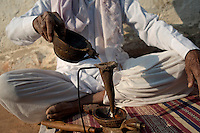 A bishnoi man making Amal(the opium drink) at his home. Bishnoi people are fond of opium. This also their ritual to greet visitors with opium drink. Jodhpur, Rajasthan, India. Arindam Mukherjee