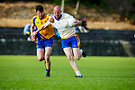 Andrew Garnett Spa breaks away from Fergal Hallissey Beaufort during their County League clash in Beaufort on Friday night