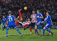 Lincoln City's Matt Green gets an overhead shot on target under pressure from Notts County's Daniel Jones and Notts County's Shaun Brisley,<br /> <br /> Photographer Andrew Vaughan/CameraSport<br /> <br /> The EFL Sky Bet League Two - Lincoln City v Notts County - Saturday 13th January 2018 - Sincil Bank - Lincoln<br /> <br /> World Copyright &copy; 2018 CameraSport. All rights reserved. 43 Linden Ave. Countesthorpe. Leicester. England. LE8 5PG - Tel: +44 (0) 116 277 4147 - admin@camerasport.com - www.camerasport.com