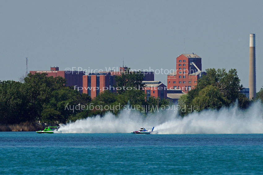"(L to R):Brian Perkins, U-21 ""Miss Gill Chiropractic"" and David Villwock, U-96 ""Spirit of Qatar"" race up the back straight."