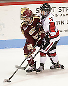 Haley Skarupa (BC - 22), Kelly Wallace (NU - 5) - The Northeastern University Huskies defeated Boston College Eagles 4-3 to repeat as Beanpot champions on Tuesday, February 12, 2013, at Matthews Arena in Boston, Massachusetts.