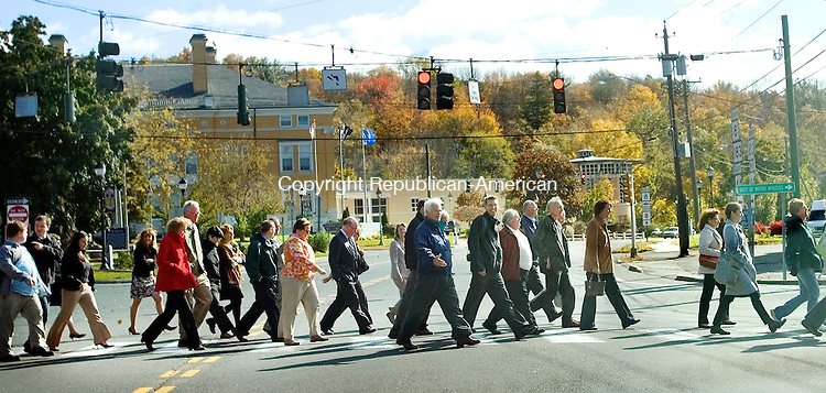WINSTED, CT. 16 October 2012-101612SV08-Nationally recognized public health, planning and transportation consultant Mark Fenton lead a walking tour of downtown Winsted Tuesday to show officials how to improve accessibility and planning for walking and biking. .Steven Valenti Republican-American