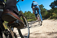 Man's legs pedaling on a mountain bike, Vitrolles, Provence, France.