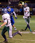 Damonte Ranch Mustangs quarterback Andrew Calingaert looks to throw a pass to #11 Samuel Banghart during their football game against the Carson Senators  on Friday night, October 4, 2013 at Carson High School.