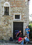 "VMI Vincentian Heritage Tour: School children look for treasures during a scavanger hunt inside the small village of Pérouges  - Tuesday, June 28, 2016, site of the classic film ""Monsieur Vincent"". (DePaul University/Jamie Moncrief)"