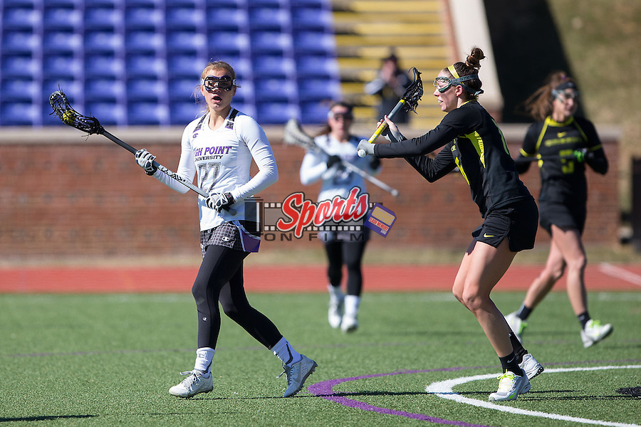 Leah Pace (27) of the High Point Panthers is checked by Casey Brogan (16) of the Oregon Ducks during first half action at Vert Track, Soccer & Lacrosse Stadium on February 15, 2015 in High Point, North Carolina.  The Ducks defeated the Panthers 9-8.   (Brian Westerholt/Sports On Film)
