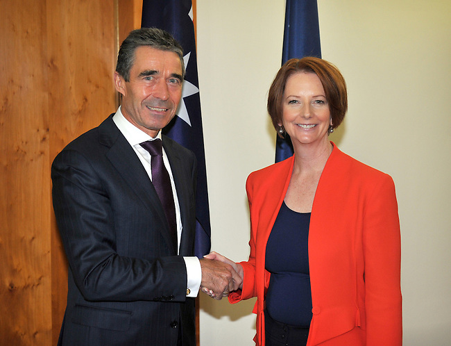 Secretary General of NATO Anders Rasmussen L shakes hands with Australian Prime Minister Julia Gillard R at her office in Parliament House Canberra, on Thursday June 14th 2012. AFP PHOTO / Mark GRAHAM