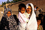 Unidentified women and children on July 23, 1996 in Herat, Afghanistan. The women are not alloved to study or work by the ruling Taliban regime. The women are forced to wear a traditional Burka dress, that covers them from top to toe due to strict Sharia laws in the country..(Photo: Per-Anders Pettersson/Liaison Agency)