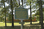 A roadside marker outside the Mt.Zion Church in Neshoba County remembers the civil rights case involving the murders of three civil rights activists poses by the commemrative sign that stands in the shadows of the Mt. Zion U.M. Church in Neshoba County Thursday May 6,2004(Photo/Suzi Altman)