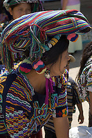 A woman wearing traditional Chajul clothing, including woven head-mat and pom-poms in her hair.