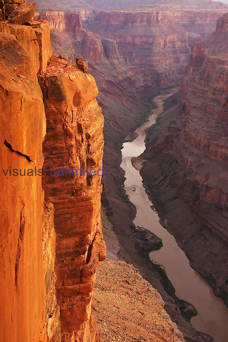 The Colorado River courses through Grand Canyon National Park at sunrise as viewed from Toroweap Overlook, over 3000 ft above the Colorado River. Arizona, USA.