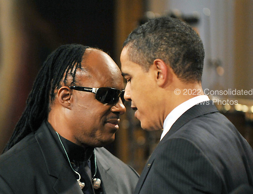 "Washington, D.C. - February 25, 2009 -- United States President Barack Obama shares some thoughts with Stevie Wonder as he and first lady Michelle Obama host ""Stevie Wonder In Performance at the White House: The Library of Congress Gershwin Prize"" to showcase an evening of celebration at the White House in honor of musician Stevie Wonder's receipt of the Library of Congress Gershwin Prize for Popular Song in the East Room of the White House in Washington, D.C. on Wednesday, February 25, 2009..Credit: Ron Sachs / Pool via CNP"