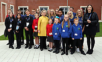 Pictured: Hillary Clinton poses with young pupils from Narberth, Pentrehafod and Blaen-y-maes Primary Schools, at Swansea University Bay Campus. Saturday 14 October 2017<br />