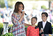 Comedian Skai Jackson and Karan Brar (R) from the comedy series Jessie make a healthy drink with First Lady Michelle Obama during the annual White House Easter Egg Roll on the South Lawn of the White House April 21, 2014 in Washington, DC. President Barack Obama and first lady Michelle Obama hosted thousands of people during the annual celebration of Easter. <br /> Credit: Olivier Douliery / Pool via CNP