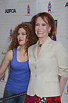 """Broadway Barks Lucky 13th Annual Adopt-a-thon - A """"Pawpular"""" Star-studded dog and cat adopt-a-thon on July 9, 2011 in Shubert Alley, New York City, New York with Bernadette Peters and Mary Tyler Moore as hosts.  (Photo by Sue Coflin/Max Photos)"""