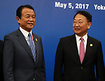 May 5, 2017, Yokohama, Japan -  Japanese Finance Minister Taro Aso (L) shares smiles with his South Korean counterpart Yoo Il-ho before starting the Japan, China and South Korea trilateral finance ministers and central bank governor's meering during the Asian Development Bank (ADB) annual meeting in Yokohama, suburban Tokyo on Friday, May 5, 2017. ADB started a four-day session for its annual meeting to celebrate the 50th anniversary of the ADB.   (Photo by Yoshio Tsunoda/AFLO) LwX -ytd-