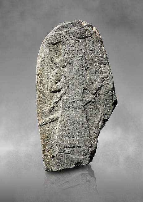 Hittite monumental relief sculpture of a God hunting, its hieroglyphic symbol is above its head. Late Hittite Period - 900-700 BC. Adana Archaeology Museum, Turkey. Against a grey art background