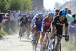 The peloton with Jonathan Dibben (GBR) Team Sky, Tony Martin (GER) Team Katusha Alpecin and Zdenek Stybar (ACE) Quick-Step Floors on the front on pave sector 29  Troisvilles a Inchy during the 115th edition of the Paris-Roubaix 2017 race running 257km Compiegne to Roubaix, France. 9th April 2017.<br /> Picture: Eoin Clarke | Cyclefile<br /> <br /> <br /> All photos usage must carry mandatory copyright credit (&copy; Cyclefile | Eoin Clarke)