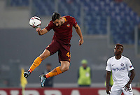 Calcio, Europa League, Gguppo E: Roma vs Austria Vienna. Roma, stadio Olimpico, 20 ottobre 2016.<br /> Roma's Kostas Manolas, left, heads the ball past Austria Wien's Olarenwaju Kayode during the Europa League Group E soccer match between Roma and Austria Wien, at Rome's Olympic stadium, 20 October 2016. The game ended 3-3.<br /> UPDATE IMAGES PRESS/Isabella Bonotto
