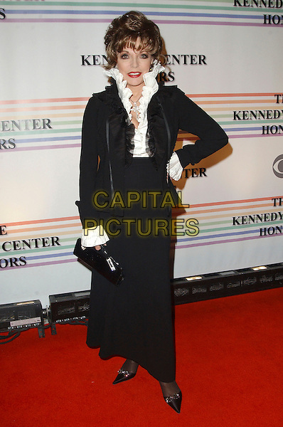 JOAN COLLINS.Arrivals - 29th Annual Kennedy Center Honors, .held at the John F. Kennedy Center for the Performing Arts, Washington, D.C. USA, 03 December 2006..full length black suit white ruffle collar shirt hand on hip.CAP/ADM/GS.©George Shepherd/AdMedia/Capital Pictures