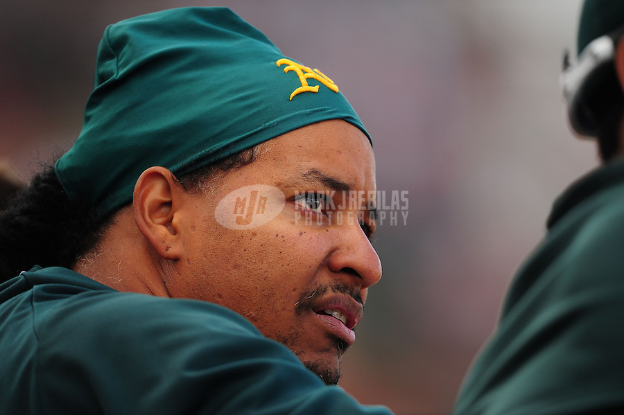 Mar. 19, 2012; Phoenix, AZ, USA; Oakland Athletics designated hitter Manny Ramirez watches from the dugout in the fourth inning against the Arizona Diamondbacks during a spring training game at Phoenix Municipal Stadium.  Mandatory Credit: Mark J. Rebilas-