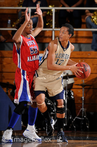 20 December 2008:  FIU's Elisa Carey (12) is defended by South Alabama's Shaniece Brunner (53) in the South Alabama 65-47 victory over FIU at the U.S. Century Bank Arena in Miami, Florida.
